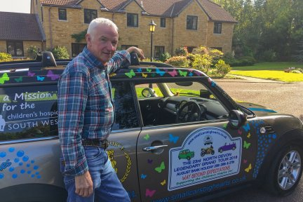 Terry Baker with his beloved Mini at Children's Hospice South West's Little Bridge House hospice in North Devon