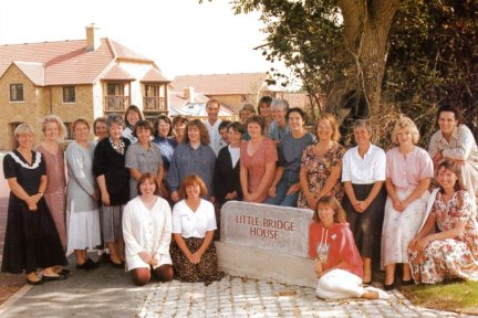 The original CHSW care team pictured outside Little Bridge House in 1995