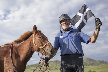 Paul Richards at finish line with Cornish flag