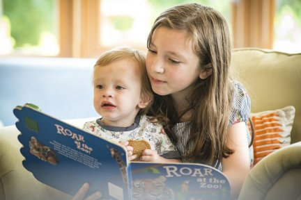 Children reading together at our Charlton Farm hospice