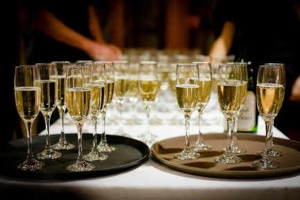 Champagne glasses on a tray at an event