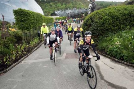 Eden Project cycling event - Eden biomes with cyclists in front