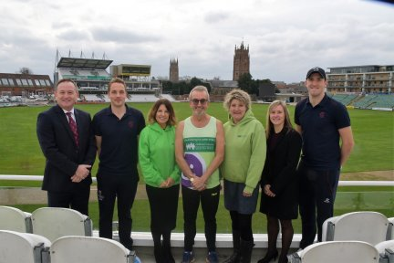 Andy Nash with Somerset CCC CEO Andrew Cornish, players Sophie Luff, Josh Davey and Craig Overton, and Emma Perry and Tracy Harvey from Children's Hospice South West at the Cooper Associates County Ground in Taunton.
