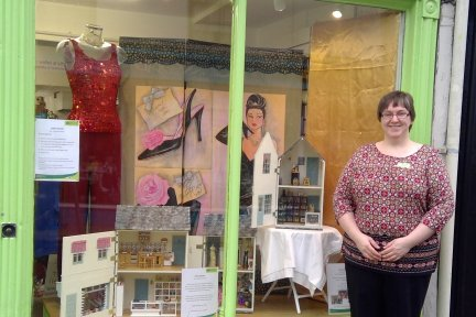 CHSW shop manager Oonagh McAreavy is pictured with the doll's houses that are based on Ashburton businesses