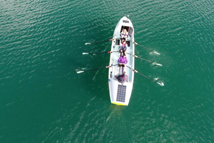 Aerial photo of the Atlantic Seamen rowing their boat in training