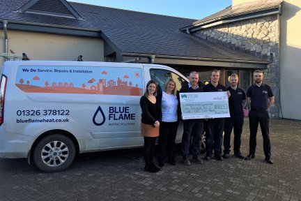 Blue Flame handover donation to Bernadette Chambers from Little Harbour