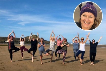 Yoga teacher Claire Jennings and students on the beach in Bude