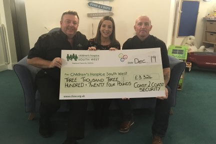 Steve and Mark from Coast 2 Coast handover their donation to Bernadette from Little Harbour