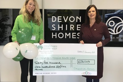 Jane Pearce (right), sales and marketing director at Devonshire Homes, presents the fundraising cheque to Mhairi Bass-Carruthers, corporate partnerships fundraiser at Children's Hospice South West