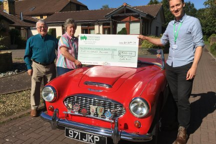 Diane and Bob Harrison present their fundraising cheque to CHSW community fundraising assistant Neville Pope at Little Bridge House