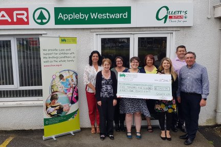 Cheque presentation with representatives from Gilletts who run SPAR stores across Devon and Cornwall