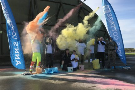 Paint station sponsors of the 2019 Newquay Rainbow Run have a practice at paint throwing before the big day