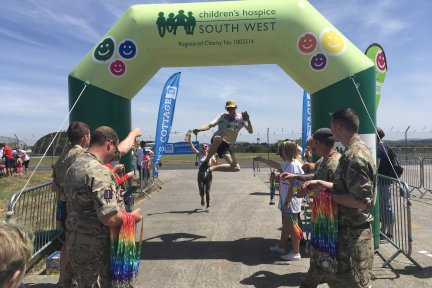 Jumping through Rainbow Run finish