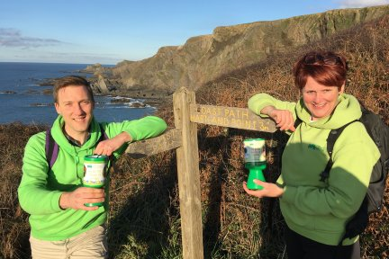 Children's Hospice South West event fundraiser Jayne Jarett and Neville Pope pictured on the South West Coast Path at Hartland Quay