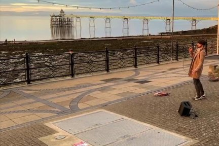 John-entertaining-the-people-of-Clevedon