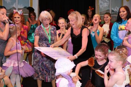 Maggy, a CHSW friends group member, receives the cheque at the dance show