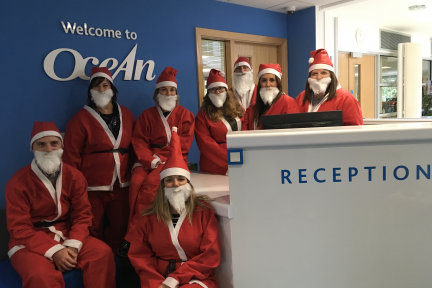Group of people dressed as Santa Claus for CHSW Santas on the Run