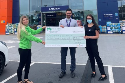 Sarah Nuttall-Worsley receives a £15000 cheque from The Range