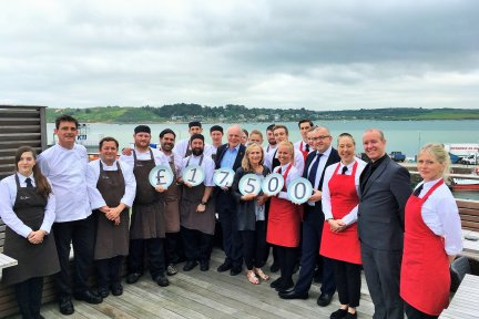 Staff from The Seafood Restaurant Celebrate the £17,500 raised from their charity lunches