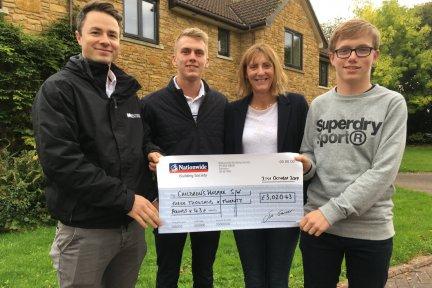 Joe Pike, mum Beverley and new junior captain Sam Pryce present the fundraising cheque to CHSW community fundraiser Josh Allan