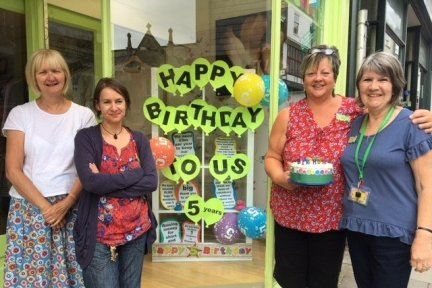 Totnes staff and volunteers celebrate the shop's 5th birthday
