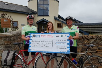RGB cyclists present cheque at Children's Hospice South West