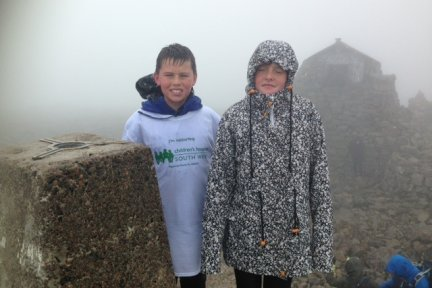 TJ and Lilly in the fog and mist at the top of one of the peaks