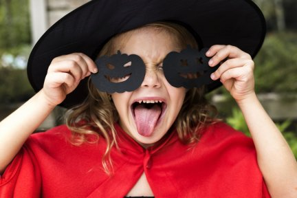 Little girl dressed up in Halloween costume