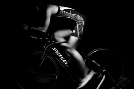 Black and white image of cyclist on bike