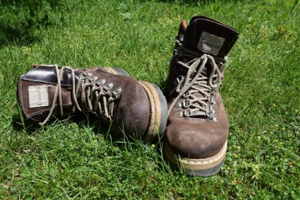 Pair of brown leather walking boots on the grass