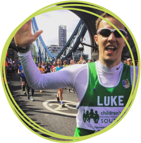 Luke Compton pictured crossing Tower Bridge in the 2017 Virgin Money London Marathon for Children's Hospice South West