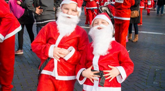 Two boys dressed as Santa