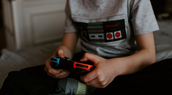 Boy holding gaming controller
