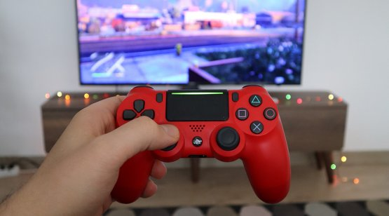 Gaming controller in front of screen