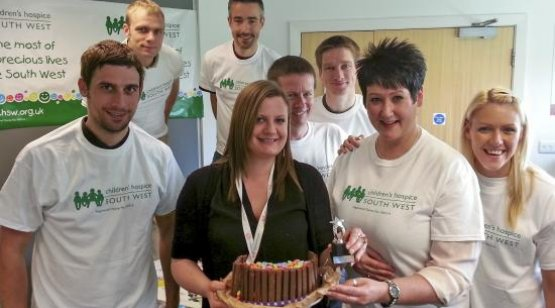 Group of smiling people with cake