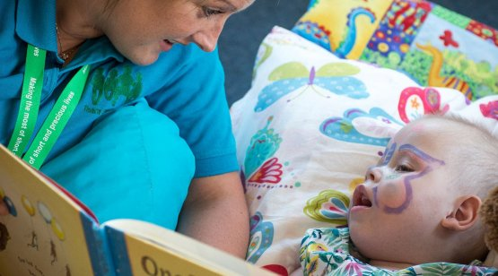 CHSW carer reading storybook with child