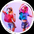 Two young women wearing headphones and nineties clothing dancing