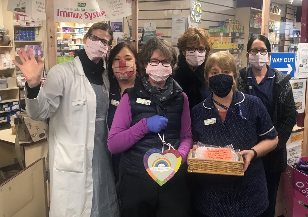 Brenda Loder (pictured second right) and her colleagues at the Bear Street Pharmacy in Barnstaple have been selling homemade facemasks in aid of Children's Hospice South West