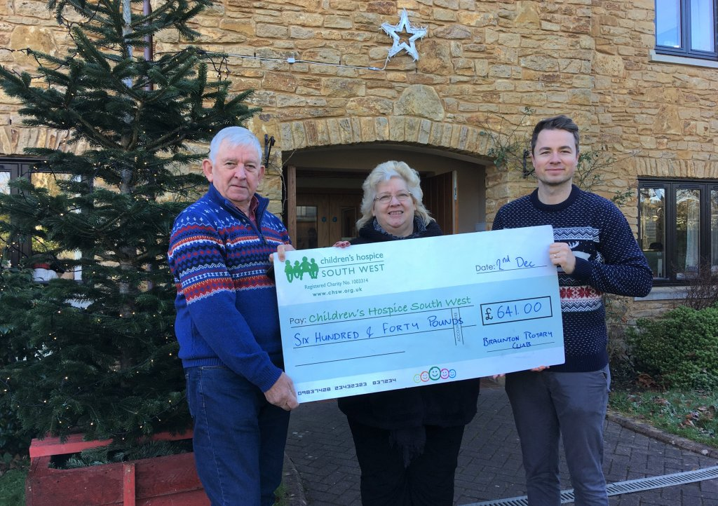 Braunton Rotary Club members Ian Welsh and Beryl Lloyd present the fundraising cheque to CHSW community fundraiser Josh Allen