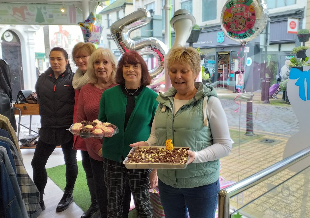 Staff and volunteers celebrate the Brixham's shop's fifth birthday