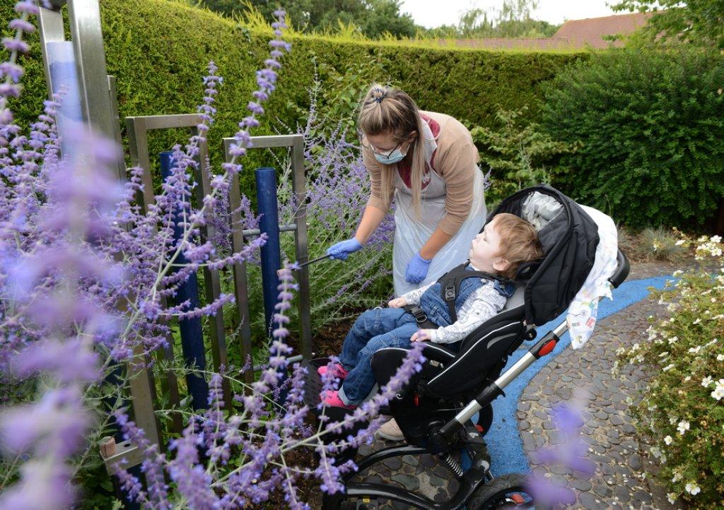 Eleanor and Kasper enjoying the gardens at Little Bridge House