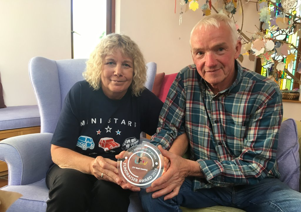 Terry and Linda Baker with the Pride of Britain award at Children's Hospice South West