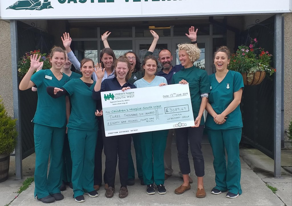 Castle Vets hand over their donation of £3877.64 for CHSW