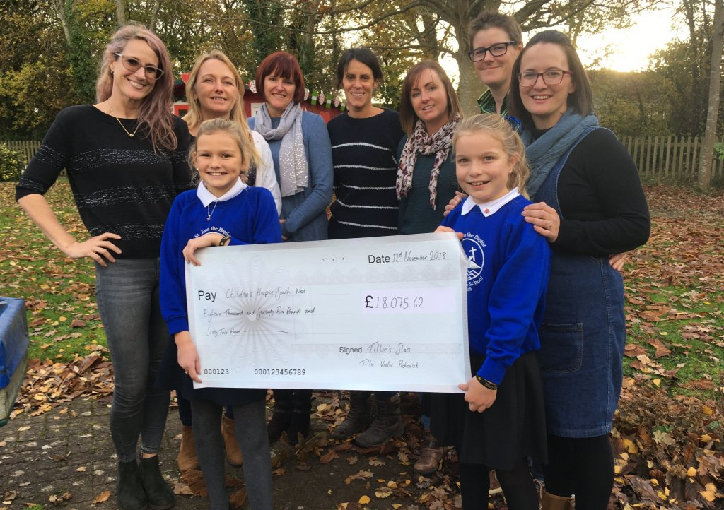 Jenny Pichowski, daughter Maisie, school friend Sophia White, and Dartmouth Amateur Rowing Club members Jo Langmead, Anna Lloyd, Ali McGrigor, Natasha Knight, Emma Alderman and Chrissy Rugg visit Little Bridge House to hand over the cheque for £18,075.62