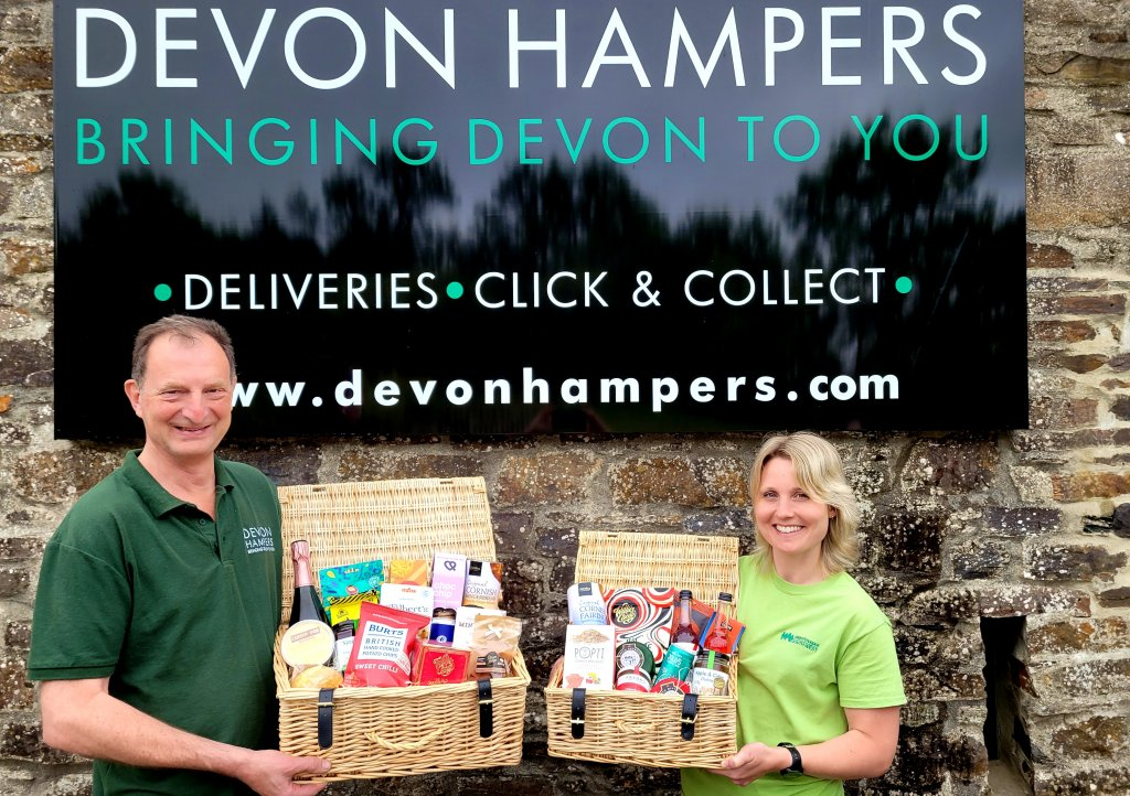 Adam from Devon Hampers with Zoe from CHSW celebrating the launch of their partnership