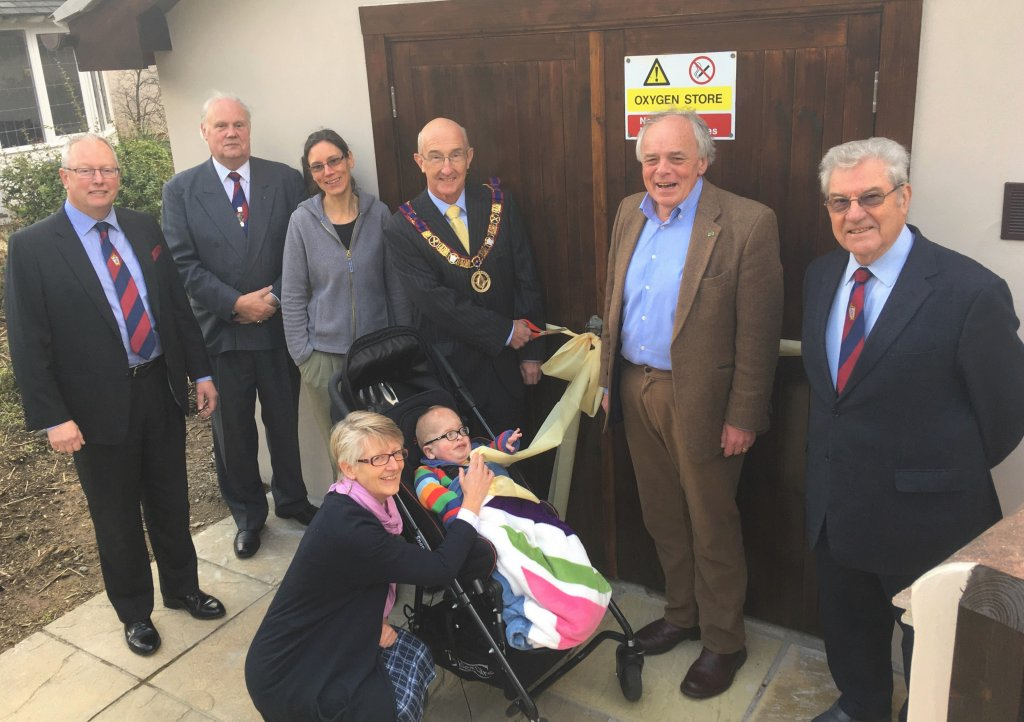 Peter Balsom cuts the ribbon with Henry Dunn, aged 4, watched by fellow Masons Trevor Jenkins, Brett Varker and Paul Howard-Baker, CHSW Chief Executive Eddie Farwell and head of care Tracy Freame.