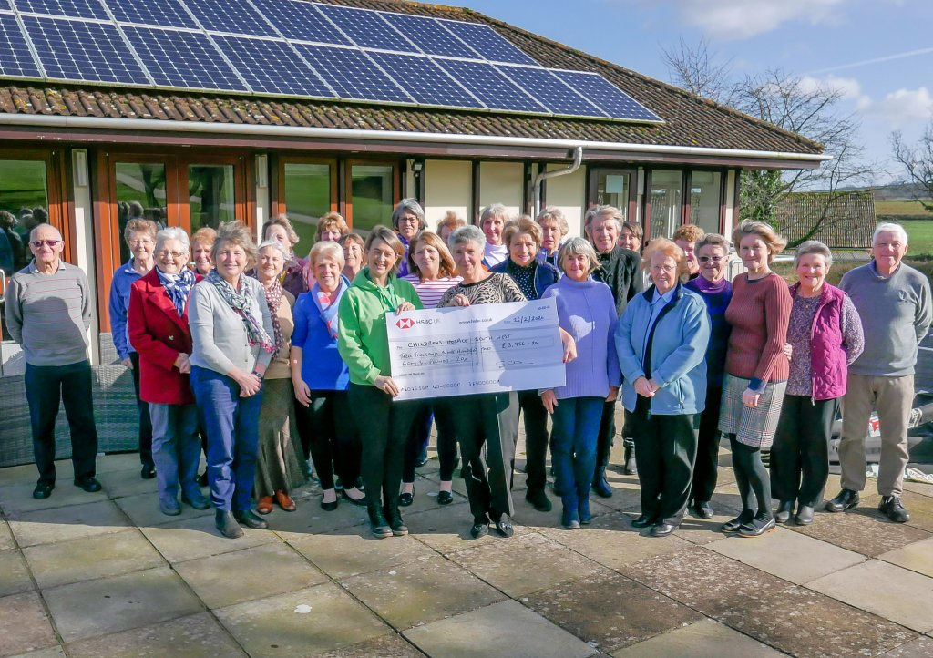 Wendy Walker and fellow members of the Enmore Park Golf Club Ladies' Section present the fundraising to CHSW community fundraiser Laura Robertson