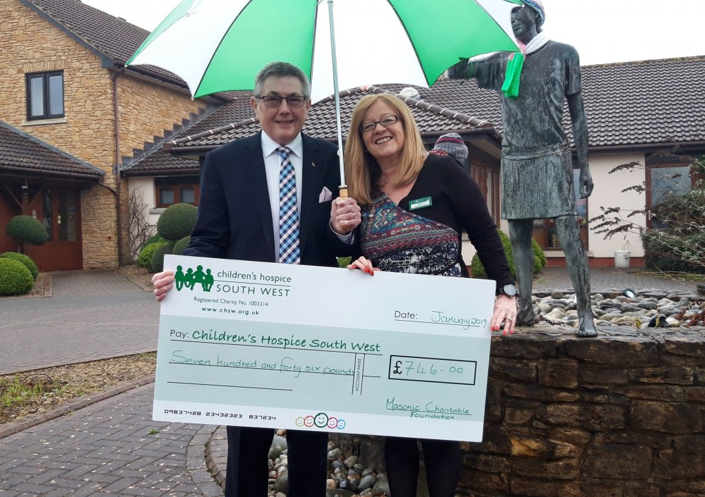 W. Bro. Charles Yelland Assistant Provincial Grand Master of the Devonshire Freemasons, presents a cheque for £746 to Ann Juby, major gifts, trusts and grants fundraiser at Children's Hospice South West