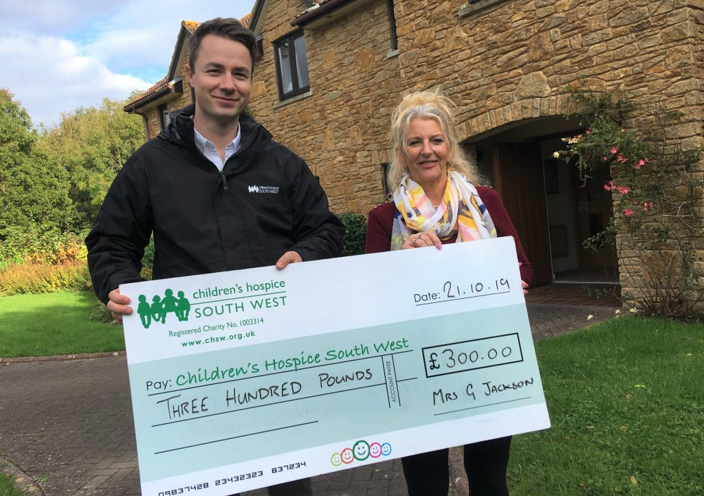 Riviera LeRoc dance group member Gracienne Jackson presents the fundraising to CHSW community fundraiser Josh Allan at Little Bridge House