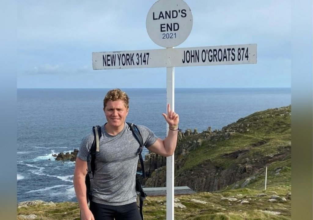 Henry Haselock, from Taunton, sets off on his 150-mile coast path challenge from Land's End in Cornwall